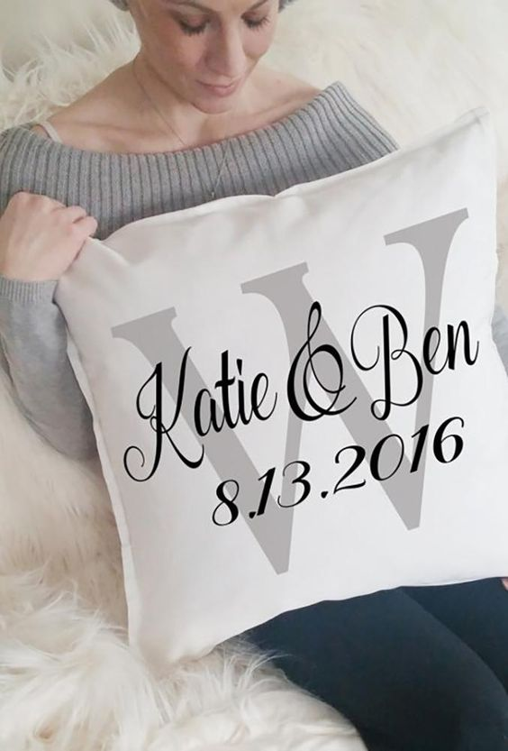 a personalized pillow with the wedding or engagement date and the names of the couple is a stylish and simple idea