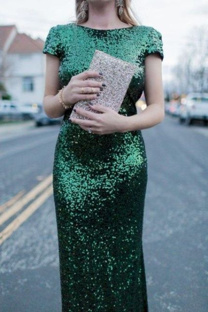 an emerald sequin sheath maxi dress with cap sleeves and a shiny clutch for a formal Christmas look