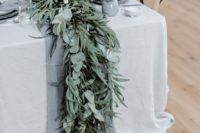 17 a grey table runner paired with a textural and lush greenery one will make your winter wedding table super cool