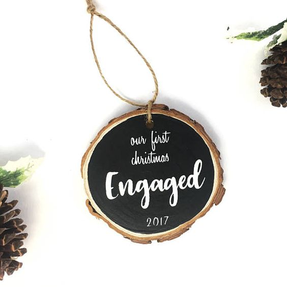 a pretty chalkboard wood slice Christmas ornament is a stylish idea for a newly engaged couple