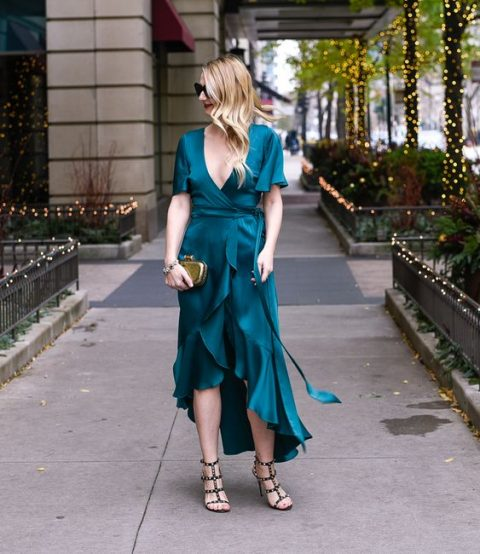a teal wrap dress with an asymmetrical ruffle skirt, a gold clutch and studded shoes for a bold look in a traditional color