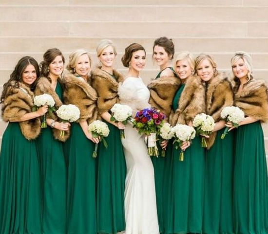 emerald green gowns and brown faux fur cover ups make up a chic and bold combo that fits winter