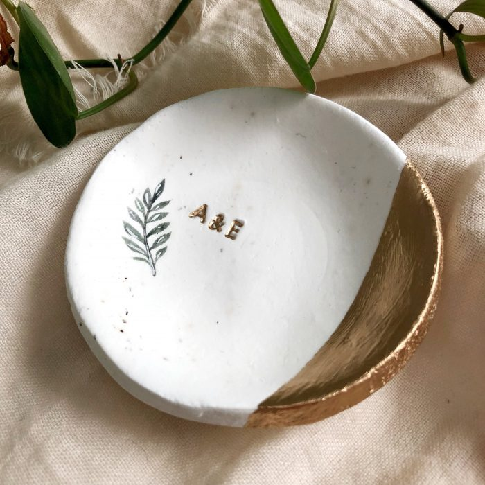 a speckled minimalist ring dish with a copper part and initials is a very chic modern idea to go for