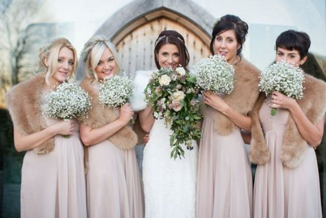 dusty pink gowns with neutral faux fur will make your bridesmaids look tender and super feminine