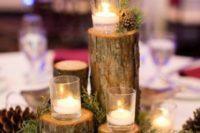 20 a cozy all-natural centerpiece of evergreens, pinecones, candles on tree stumps for winter