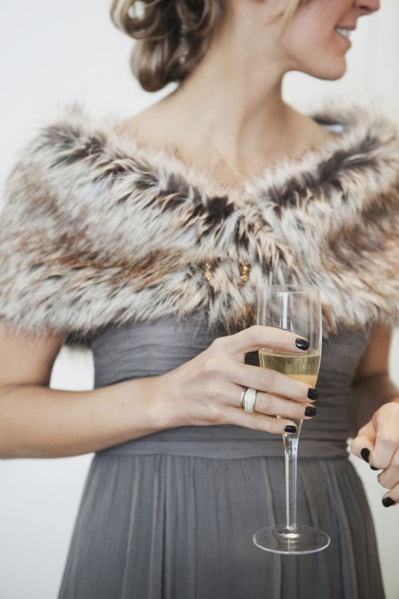 a grey bridesmaid's dress looks awesome with a brown faux fur stole creating a trendy and edgy modern look