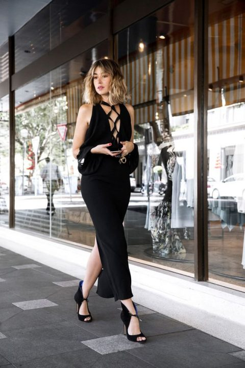 a super chic black sheath maxi dress with a cold shoulder and a lace up front plus gorgeous booties