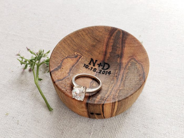 a wood ring dish of ambrosia maple wit initials and an engagement or wedding date is a gorgeous idea