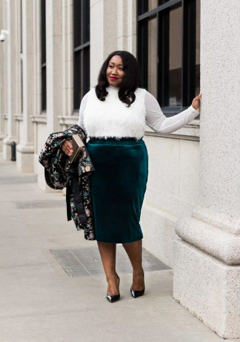 a chic look with an emerald velvet midi, a white top with a feather front and black shoes plus a bold printed coat