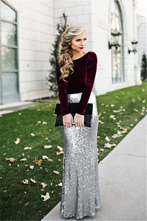 a deep purple velvet top with long sleeves, a silver sequin maxi skirt and a black clutch for a breathtaking look