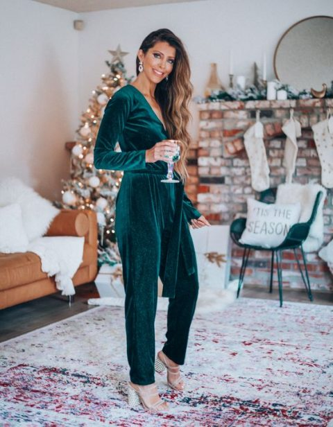 an emerald velvet jumpsuit with long sleeves, a V-neckline and metallic shoes for a refined look