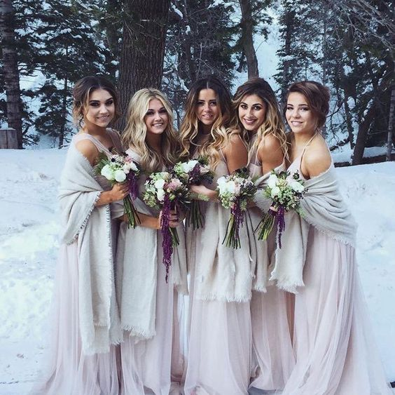light pink maxi bridesmaid dresses with thick and spaghetti straps and neutral pashminas for a tender and soft look