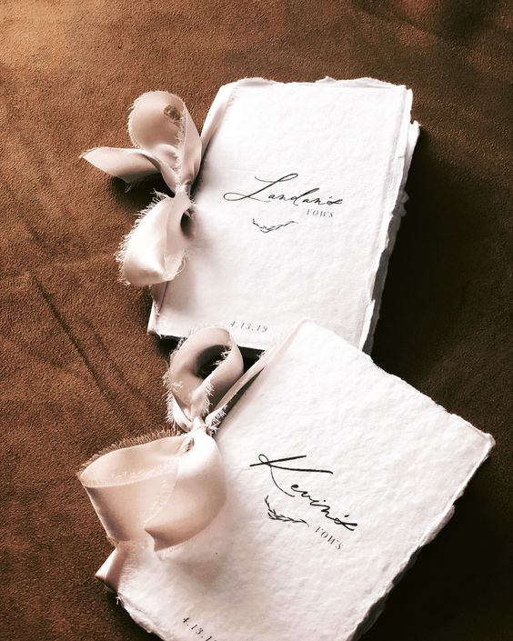vow books with a raw edge and blush bows will be appreciated by the couple which is getting married