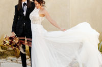 01 This couple went for a gorgeous wedding with impeccable taste and lots of dramatic touches