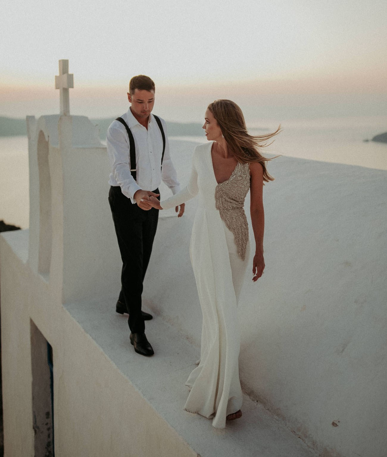 This magical Santorini wedding was done with tropical florals, lots of lights and Santorini magic