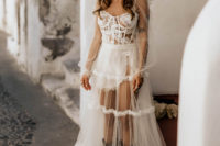 02 The bride was wearing a see-through wedding dress with a corset, a neck, cowboy boots and a black hat
