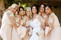 02 The bridesmaids and gals were getting ready in very chic robes with lace appliques