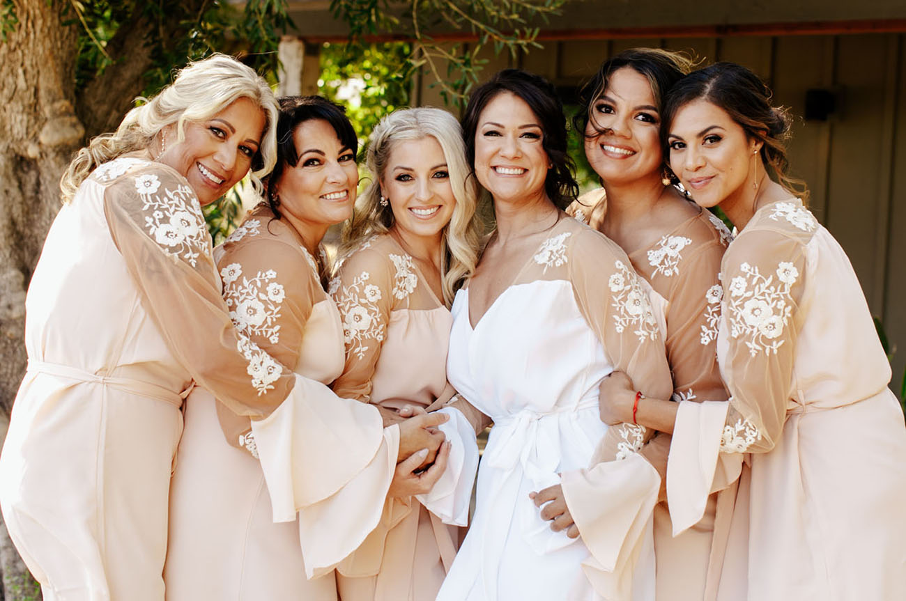 The bridesmaids and gals were getting ready in very chic robes with lace appliques