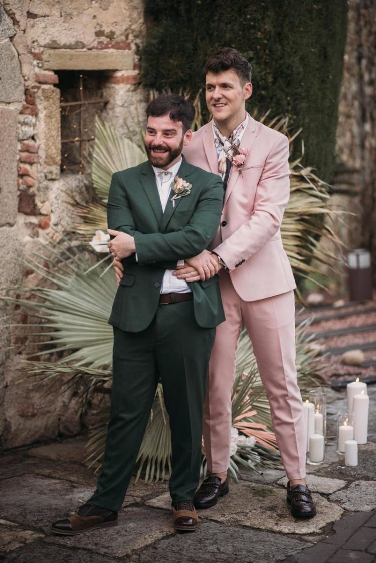 The grooms were wearing stylish outfits - a green and a pink suit with a tropical print shirt and chic moccasins