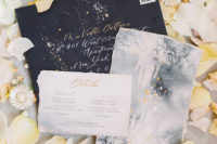 02 The wedding stationery was done in black, grey and neutrals, with elegant calligraphy and a raw edge