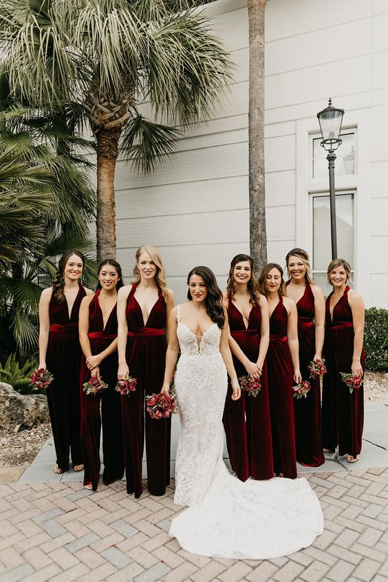burgundy velvet jumpsuits with deep necklines look very refined and very chic