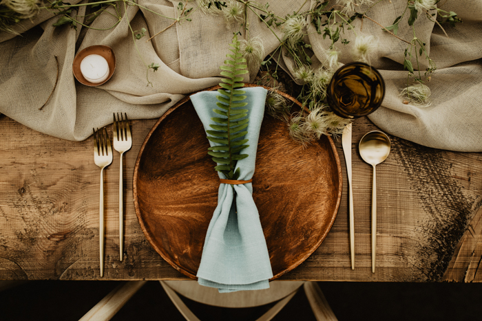 choose wooden chargers and non-dyed linens for decorating your table and your wedding will be more eco-friendly