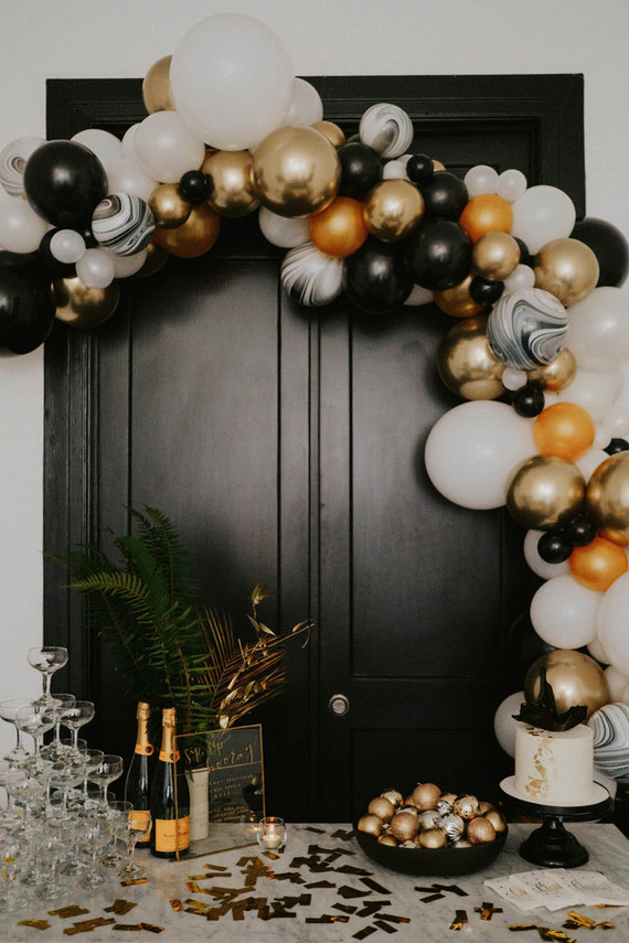 The bar was decorated with black, white and gold balloons and touches of marble plus greenery