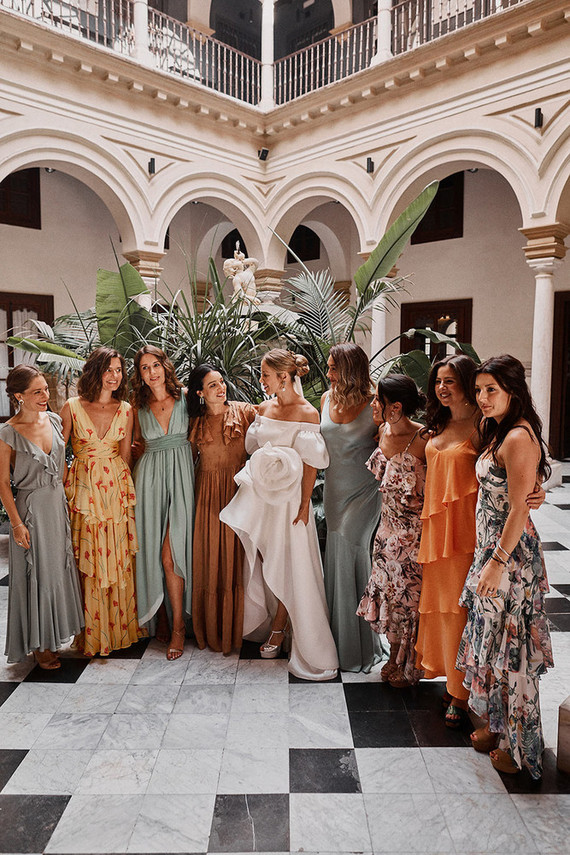 The bridesmaids were wearing long dresses in colors and looks that they liked