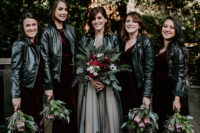 03 The bridesmaids were wearing mismatching burgundy velvet dresses and everyone covered up with a black leather jacket