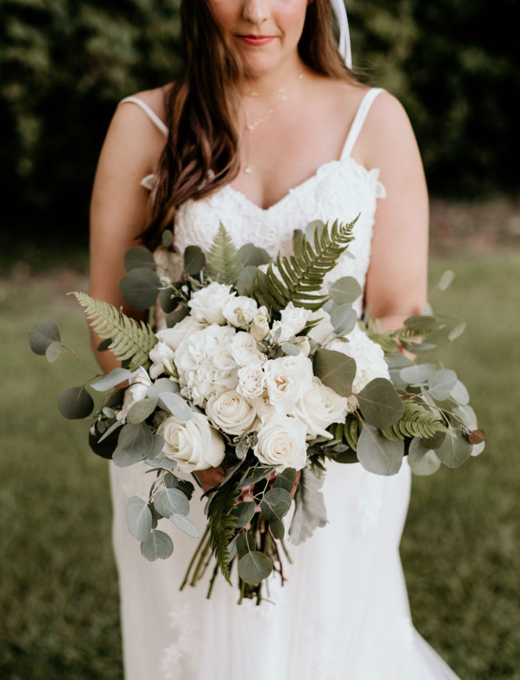 The wedding bouquet was done with white blooms and textural greenery