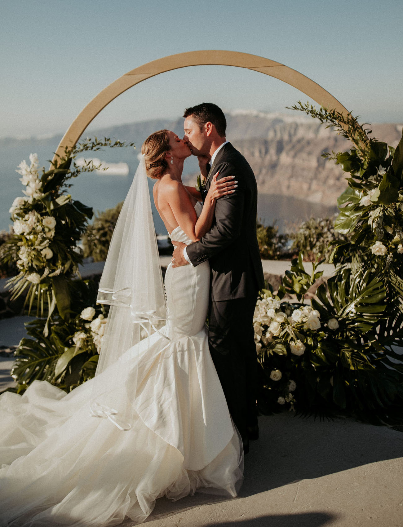The bride was wearing a strapless mermaid wedding dress with a veil and a train, the groom rocked a classic black tux