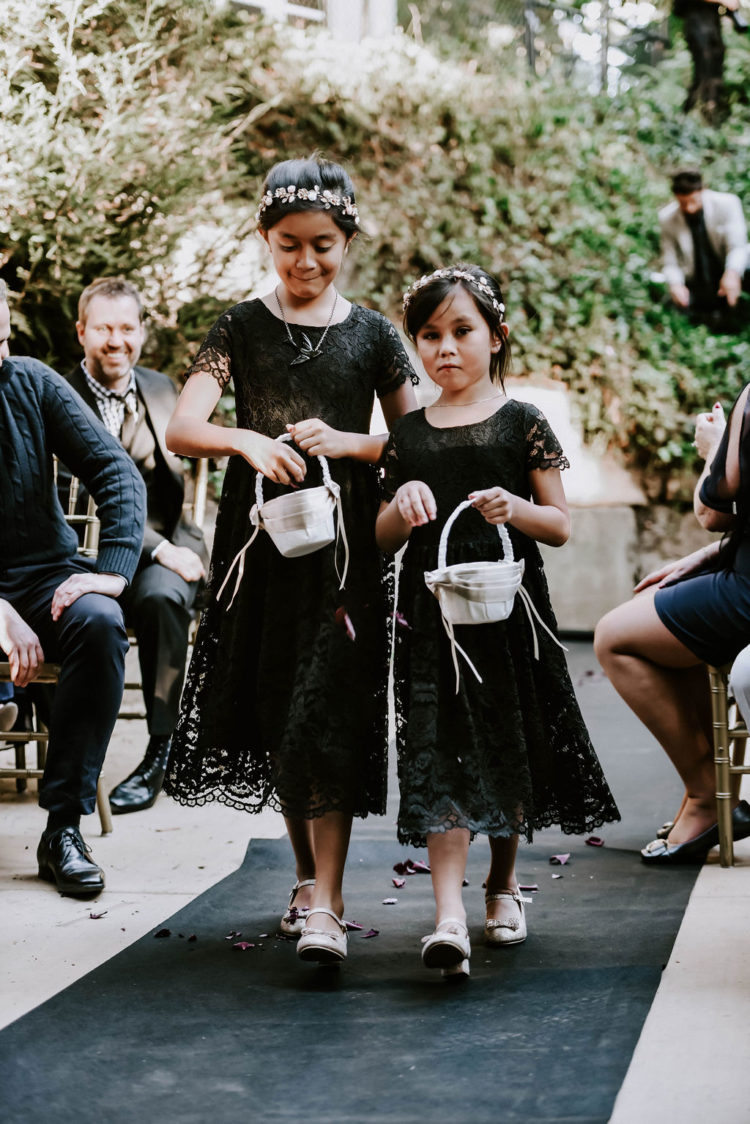 The flower girls were wearing black lace dresses