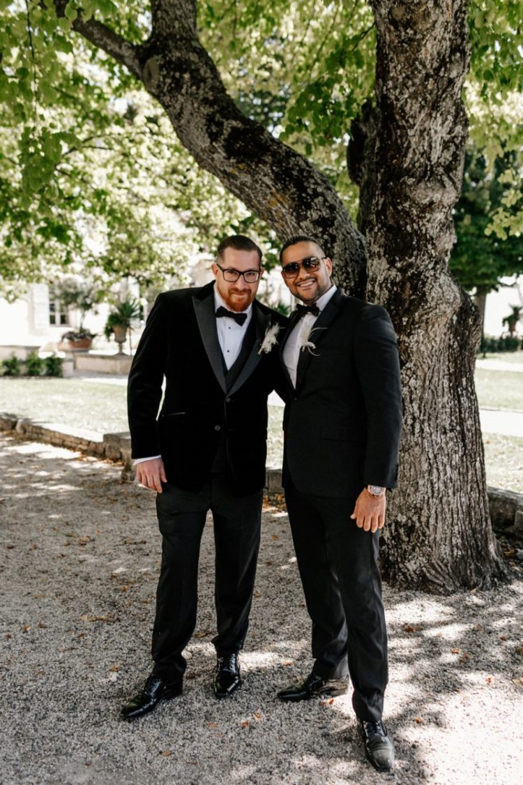 The groom and groomsmen were rocking black velvet tuxedos