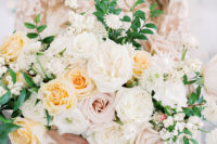 04 The wedding bouquet was done in neutrals, with blusha nd peachy roses and some greenery