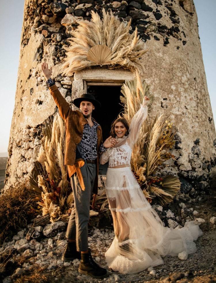The wedding ceremony site was an antique mill decorated with pampas grass