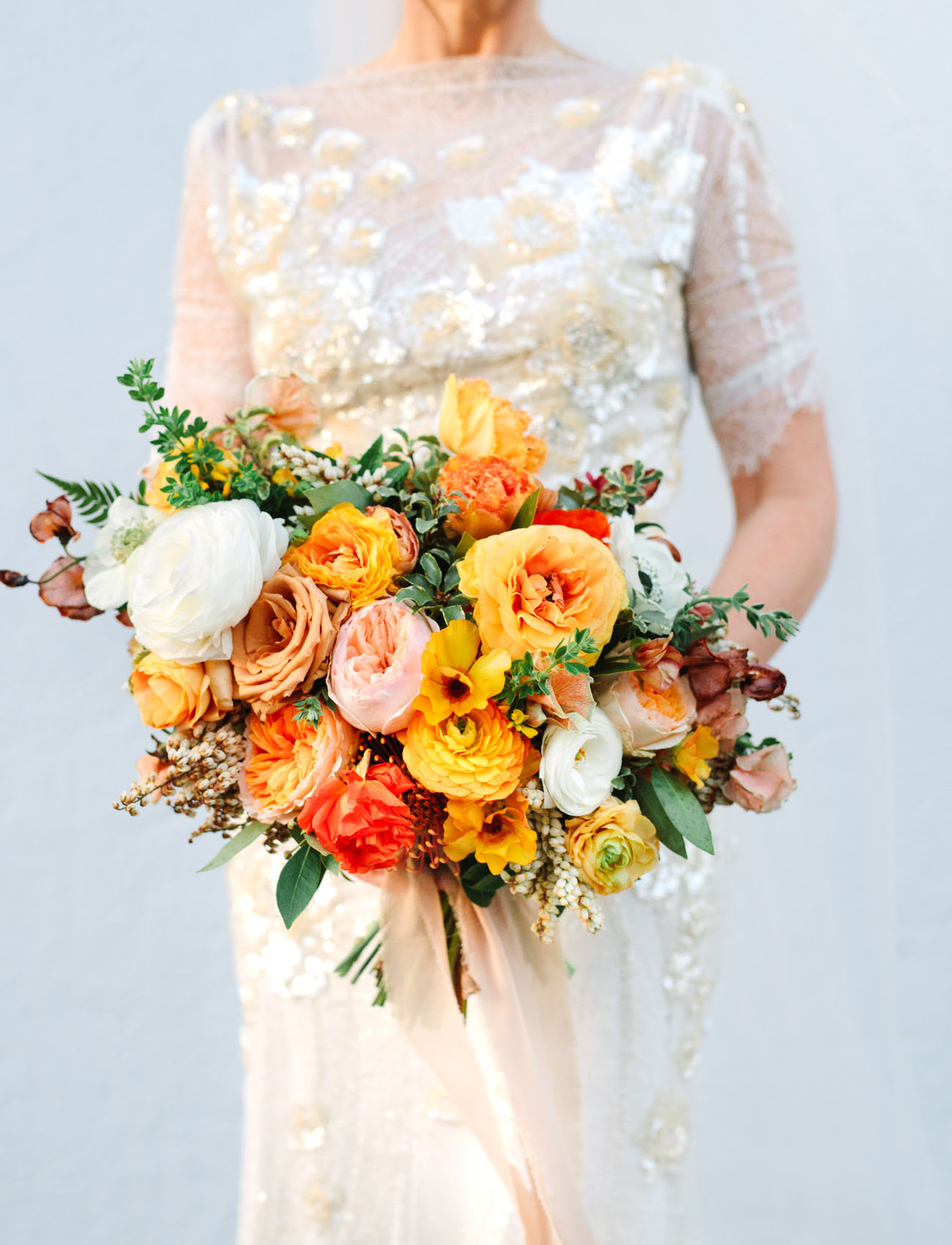 Look at the fantastic wedding bouquet with lush blooms in sunny shades