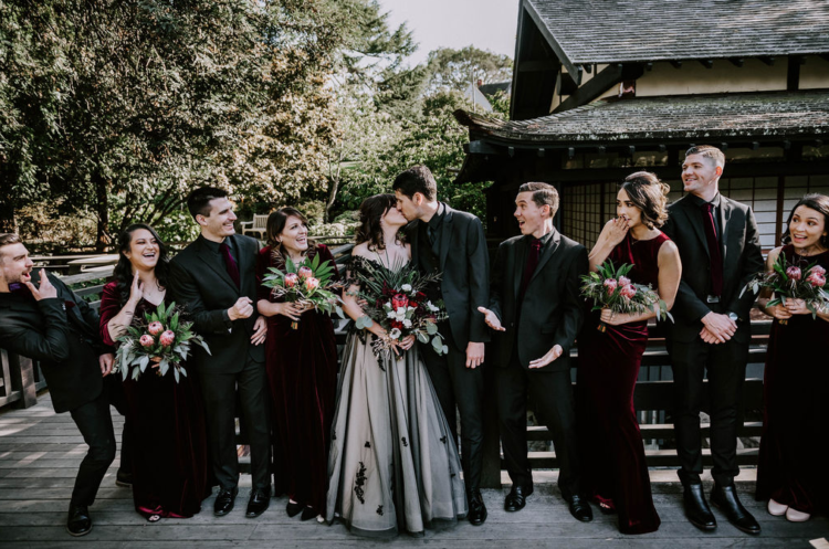 The groom and groomsmen were wearing black, and guys were rocking burgundy velvet ties