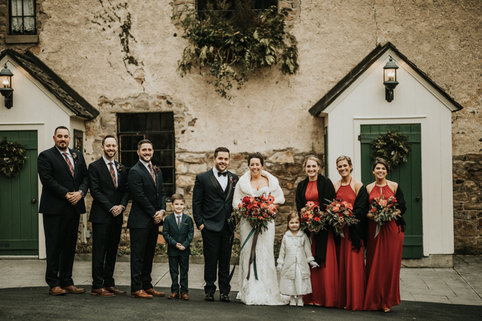 The groomsmen were wearing grey suits with plaid ties and the bridesmaids were wearing red halter neckline maxi dresses