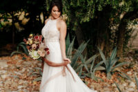 05 The second bride was wearing a chic A-line wedding dress with a lace bodice and a halter neckline plus a train