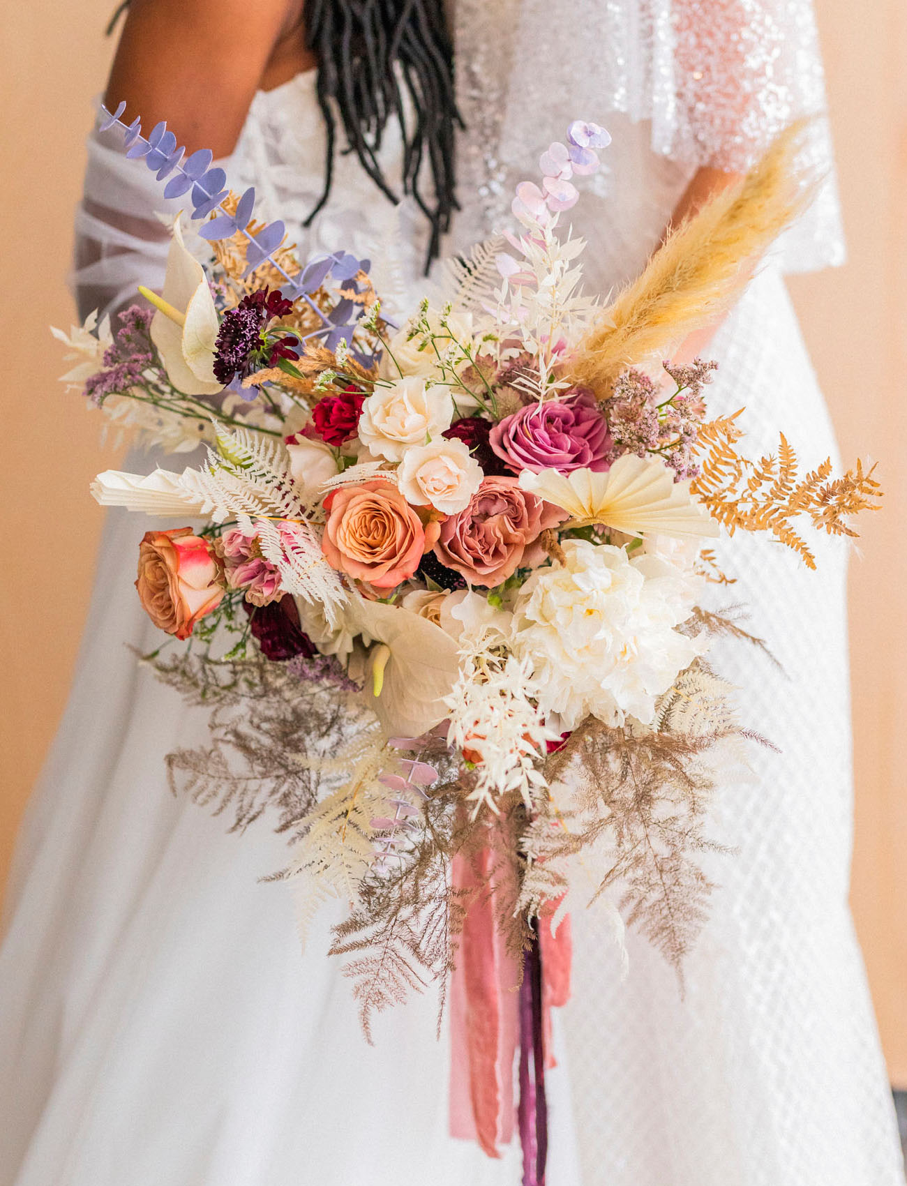 The wedding bouquet was spectacular, in peachy, pink, neutrals and purple