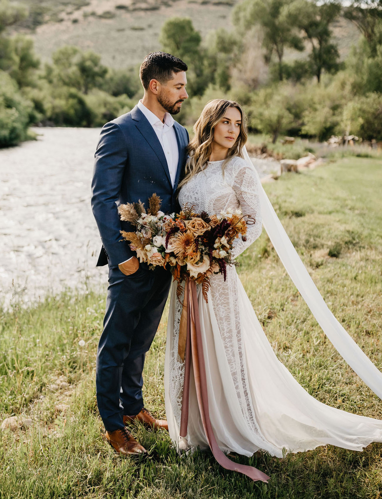 The wedding dress was a lace A line one, with long sleeves, a cutout back and a train