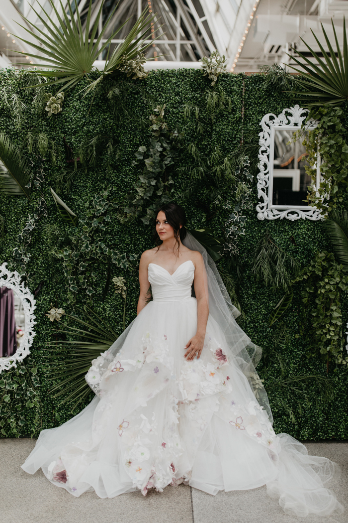 The wedding dress was by Hailey Paige, with pink and white blooms