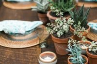 05 create a wedding table runner of potted greenery and succulents and candles to make a cool look