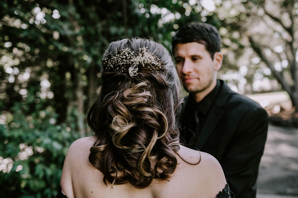 The bridal hair was a half updo with a chic crystal headpiece