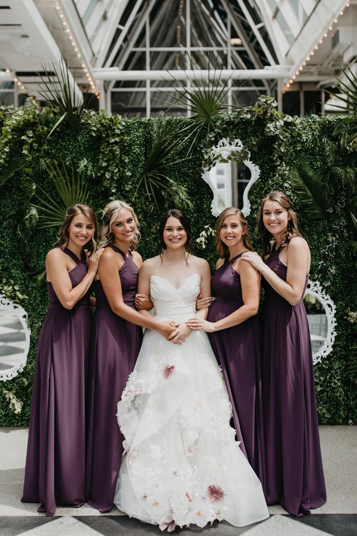 The bridesmaids were rocking purple halter neckline maxi dresses