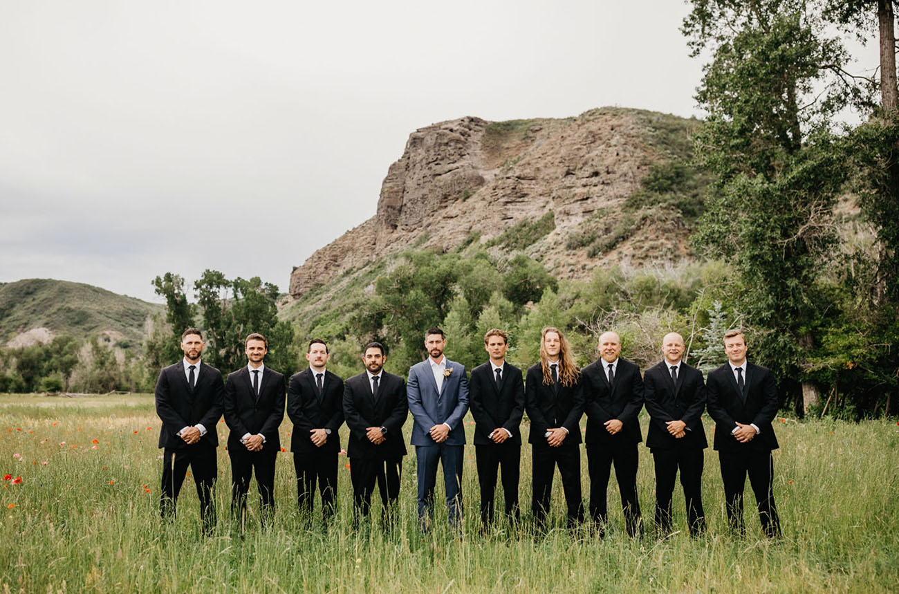 The groom was wearing navy, and the groomsmen rocked black suits with black ties