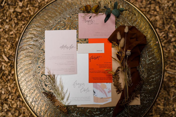 The wedding stationary was done in orange and pink and with watercolors
