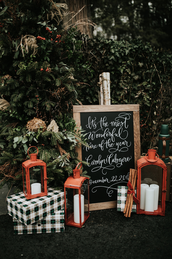 The wedding was filled with cute holiday touches   plaid, red lanterns, fir and evergreens