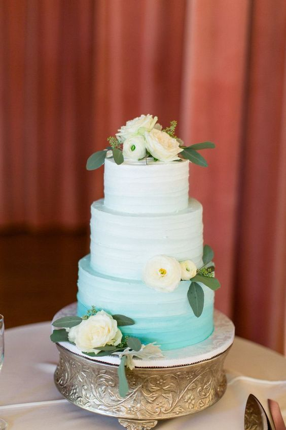 a chic ombre white to aqua wedding cake decorated with white blooms is a cool idea for a wedding