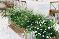 06 a mini herb garden with white blooms is a nice wedding centerpiece idea for a rustic wedding